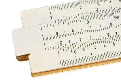 Old slide-rule for computing. Close-up. Isolated. With path